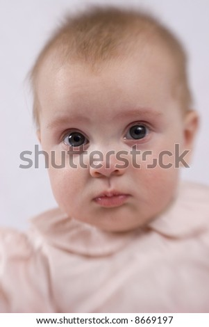 Close-up of a serious baby girl taken with a Lens-baby.