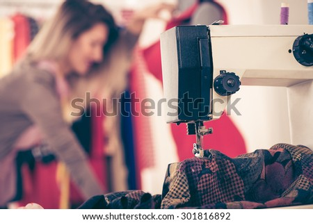 Close-up of a sewing machine with a material that sew. - stock photo