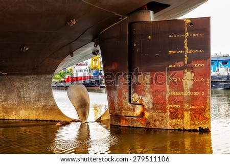 Close up of a ship propeller and rudder. - stock photo