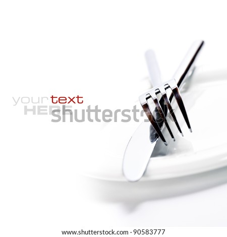 Close up  of a silver knife and fork on a white background (with sample text)