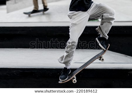Close up of a skateboarders feet while skating - stock photo