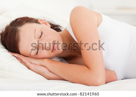Close up of a sleeping beautiful woman in her bedroom