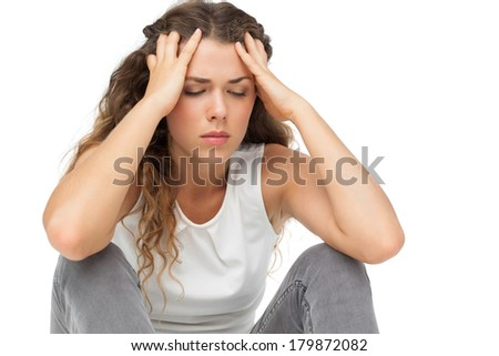 Close-up of a sleepy young woman over white background - stock photo