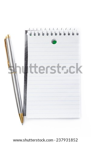 close up of a small note pad and a pen as a reminder concept - stock photo