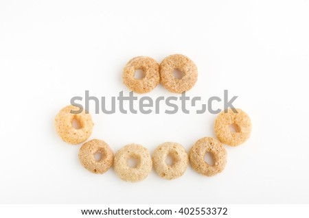 Close-up of a smile of round breakfast cereals. - stock photo