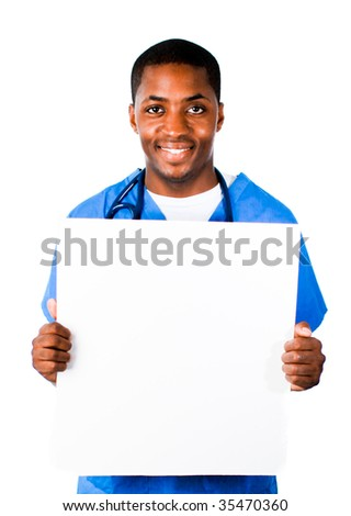 Close-up of a smiling Afro-American doctor wearing scrubs and holding a white card