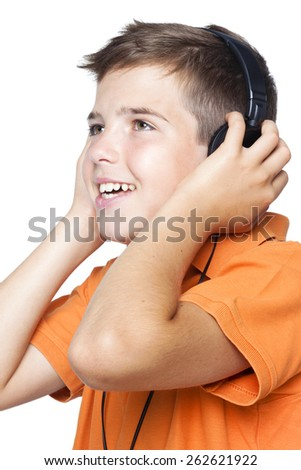 Close-up of a smiling boy with headphones listening to music, isolated on white background - stock photo