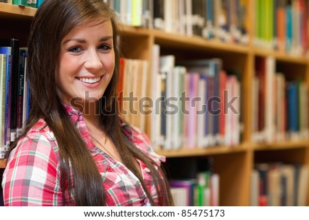 Close up of a smiling female student looking at the camera - stock photo