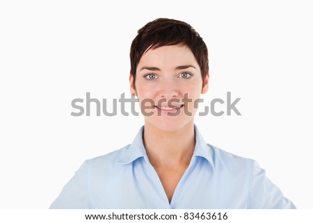 Close up of a smiling woman against a white background - stock photo