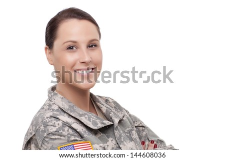 Close-up of a smiling young female soldier  - stock photo
