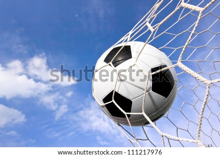close-up of a soccer ball (football) going into the back of the - stock photo