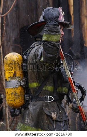 Close-up of a Southwest Detroit Fireman fighting a house fire - stock photo