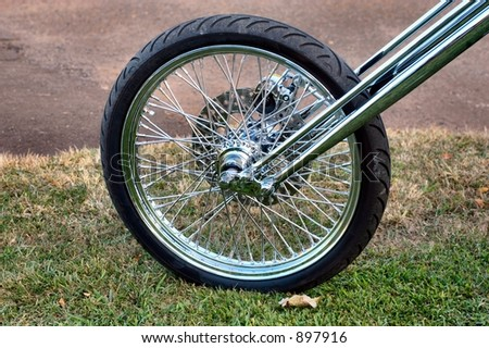 Close-up of a Spoked Chopper Motorcycle Wheel - stock photo