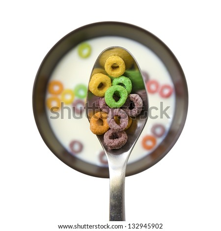 Close up of a spoon above a bowl with cereals and milk, isolated on white background - stock photo