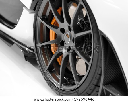 Close up of a sports car�´s alloy wheel - stock photo