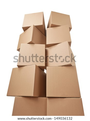 close up of a stack of cardboard boxes on white background - stock photo