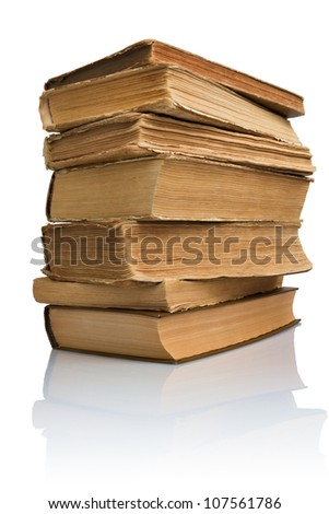 Close-up of a stack of old books with reflection - stock photo