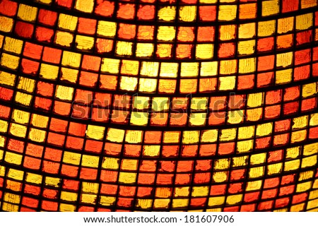 Close up of a stained glass lighting fixture - stock photo