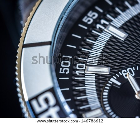 Close up of a steel chronograph. Selective focus, shallow depth of field. - stock photo