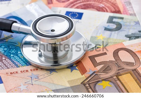 Close-up of a stethoscope on euro bills - stock photo