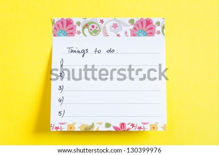 Close up of a sticky note saying Things To Do list - yellow background - stock photo