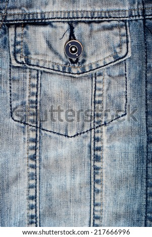 Close-up of a stone washed denim jacket - stock photo