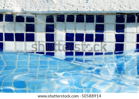 close up of a swimming pool in the summer - stock photo