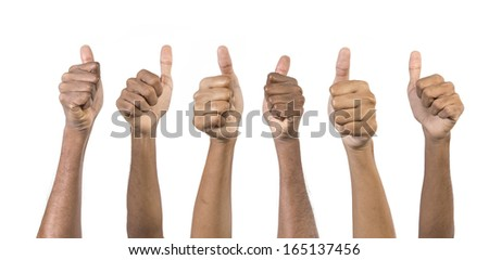Close-up of a team of Indian men and women's with Thumbs Up upward - stock photo