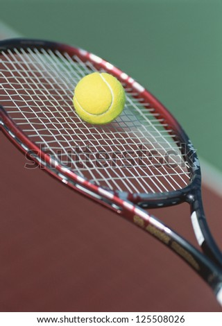 Close up of a tennis ball and racket - stock photo