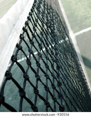 Close up of a tennis net - stock photo