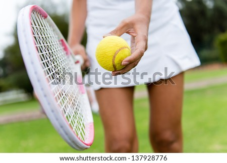 Close up of a tennis player hitting the ball with racket - stock photo