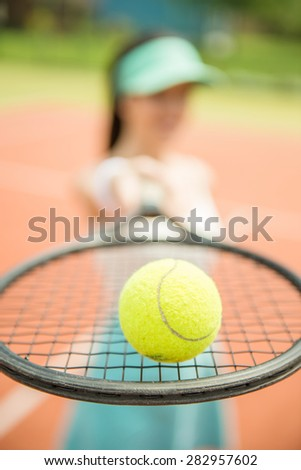 Close up of a tennis player hitting the ball with racket. - stock photo