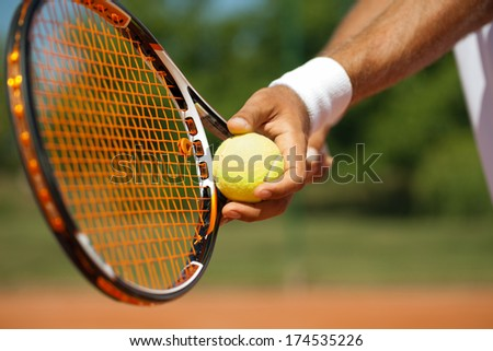 Close up of a tennis player standing ready for a serve - stock photo