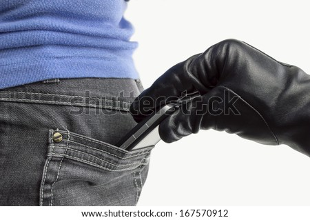 close up of a the hand of a thief stealing the phone to a woman - stock photo