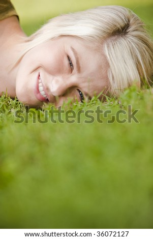 Close-up of a thoughtful young woman resting in the park - stock photo