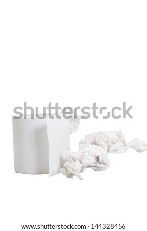 Close-up of a toilet paper roll with crumpled papers - stock photo