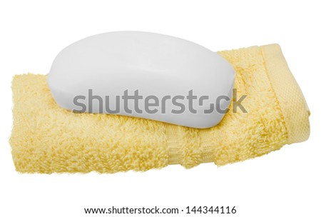 Close-up of a towel with a bar of soap - stock photo