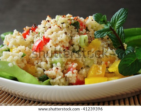 Close up of a traditional Arabian dish: Tabbouleh salad with couscous, tomatoes and parsley.