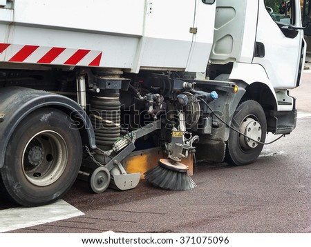 Close up of a truck cleaning a street