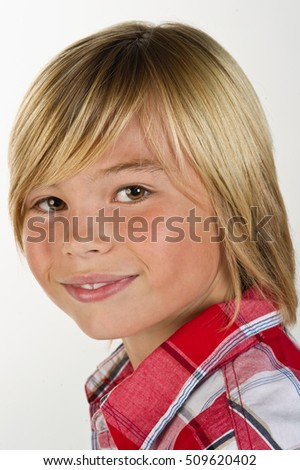 close-up of a tween boy smiling at the camera