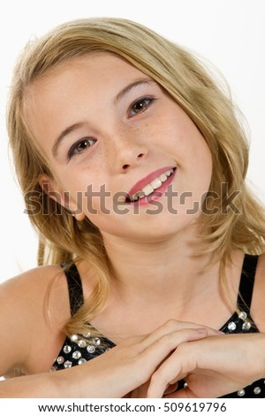 close-up of a tween girl smiling at the camera