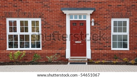 close-up of a typical british residential house with small entrance garden - stock photo