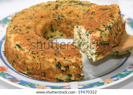 Close up of a vegetable pie. Focus on the slice. - stock photo