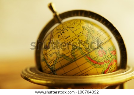 Close-up of a vintage globe. - stock photo