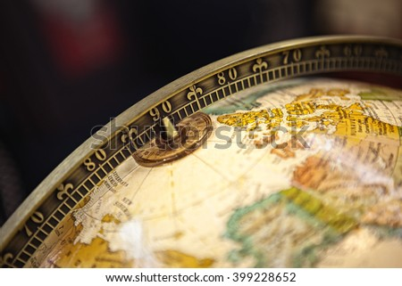 Close-up of a vintage globe. dark background - stock photo