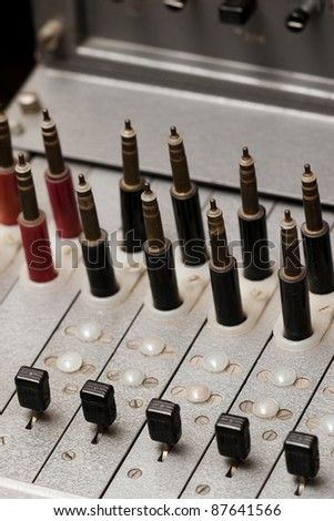 Close up of a vintage telephone switchboard with multiple lines, old telecommunications technology - stock photo