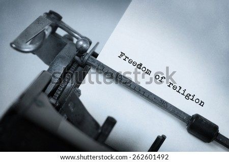 Close-up of a vintage typewriter, old and rusty, freedom of religion - stock photo