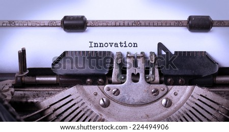 Close-up of a vintage typewriter, old and rusty, innovation - stock photo