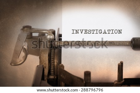 Close-up of a vintage typewriter, old and rusty, investigation - stock photo