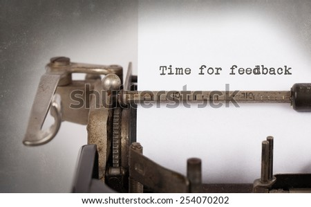 Close-up of a vintage typewriter, old and rusty, time for feedback - stock photo